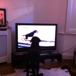 Puppy Alfie watching another dog on TV
